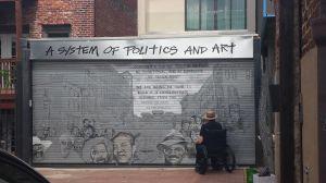 An artist at work in Blagden Alley in D.C.
